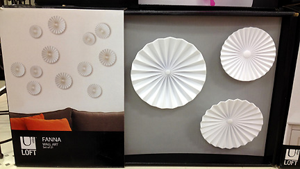 Modern white disks used to create art installation. By Umbra, at Target.