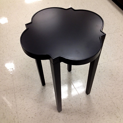 A decorative, black side table by Threshold at Target.