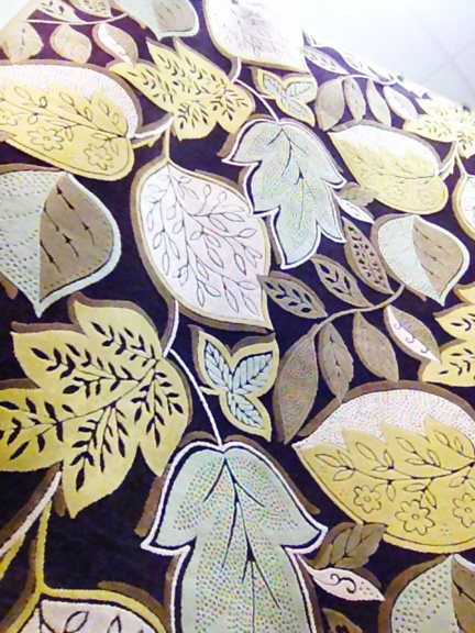This 8x11 rug at Home Goods in Austin, TX features a modern leaf motif in chocolate brown, mint green and citron yellow.