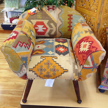 This modern club chair at Home Goods in Austin is upholstered with a kilim rug.