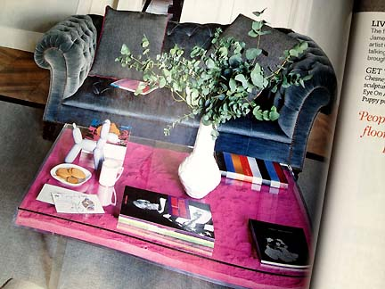 A plexiglass coffee table displays hot pink sand, as featured in the February 2013 issue of the UK's Livingetc modern home decor magazine.