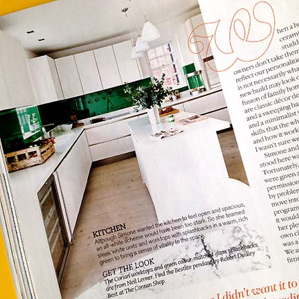 This modern kitchen, featured in Livingetc's February 2013 issue, has an emerald green glass backsplash.