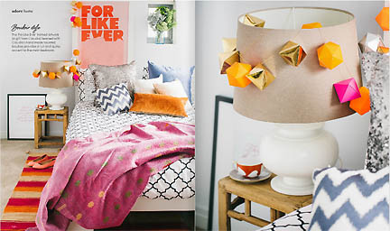 A modern girl's bedroom decorated in pink, orange, white and black is featured in the Feb/Mar 2013 issue of Australia's online home decor magazine, Adore.