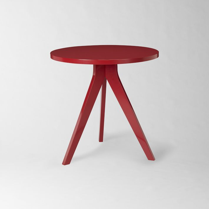 West Elm's tripod side table in red.