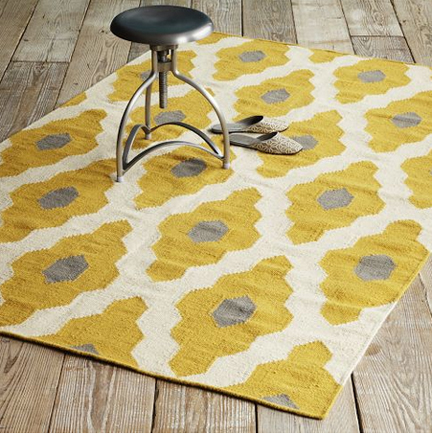 Bazaar wool dhurrie rug from West Elm, featuring modern ikat pattern in gold and gray.