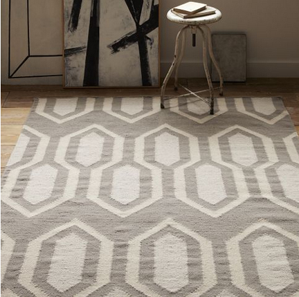 West Elm gray dhurrie wool rug in gray and white geometric pattern.