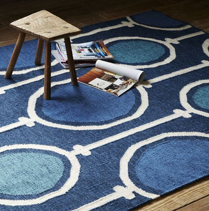 Navy blue links wool dhurrie rug from West Elm.