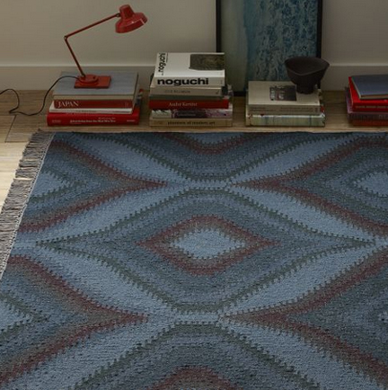 West Elm mid-century inspired modern wool rug in navy blue geometric pattern.