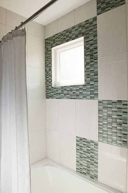 Modern boys' bathroom Rollingwood Austin TX glass tile shower tub surround
