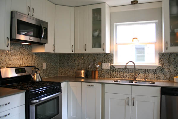 White shaker kitchen remodel modern herringbone backsplash quartz counters Austin Travis Country