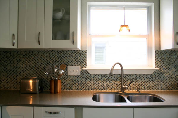 Austin kitchen remodel white shaker cabinets quartz countertops modern herringbone backsplash