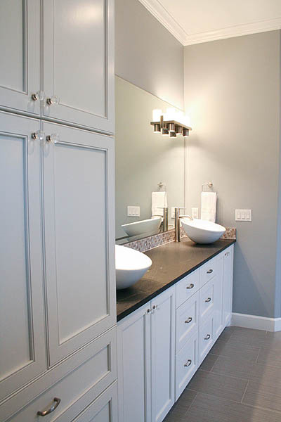benton_master_bath_double_vanity_leathered_counter_penny_marble_backsplash_modern _white_cabinets_2