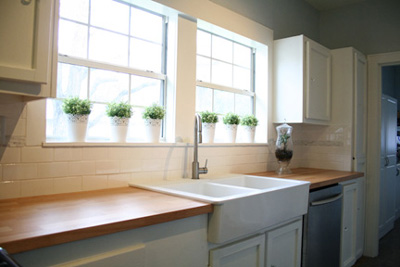 white kitchen butcherblock counter farmhouse sink 1
