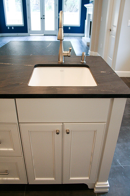 austin-white-kitchen-black-leather-countertop-prep-sink_web