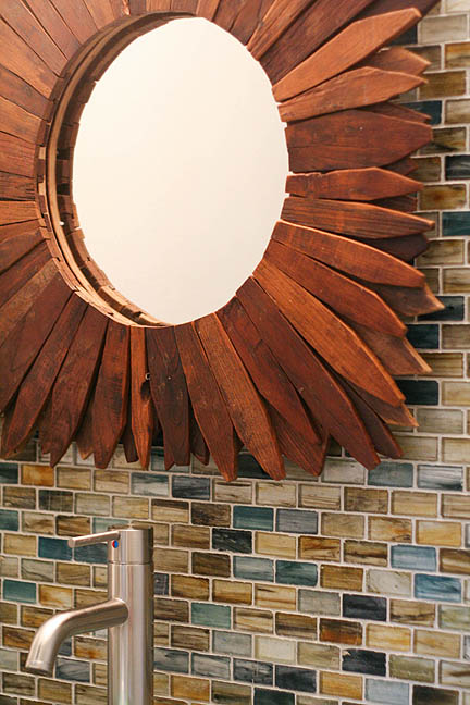 glass-tile-natural-colors-soapstone-countertops-teak-wood-starburst-mirror-austin-powder-room_web
