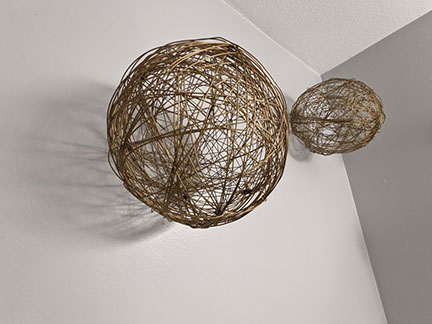 Twig balls used as accessories bring a natural element to this modern bathroom remodel in Austin, Texas.